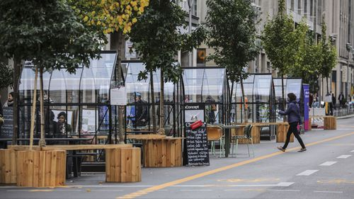 Mostly empty seating capsules can be seen outside a coffee-shops at Friedrichstraße on October 9, 2020 in Berlin, Germany.