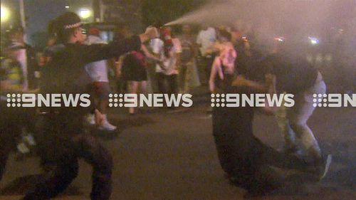 Police were forced to employ pepper spray as violence erupted. (9NEWS)