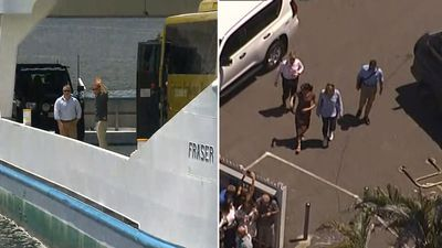 Land ahoy! Royals split on arrival for Fraser Island visit
