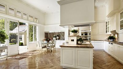 The large kitchen featured marble benches and splash-backs with parquetry flooring. (Supplied, Kay and Burton Real Estate)