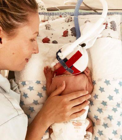 Premmie baby arlo mum hand hold