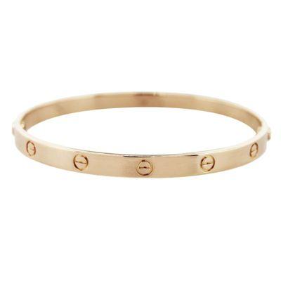 """<a href=""""http://www.au.cartier.com/en-au/collections/jewelry/collections/love/bracelets/b6035517-love-bracelet.html"""" target=""""_blank"""">Love bracelet, $8800, Cartier</a>"""