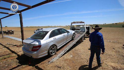A luxury Mercedes Benz was also seized.