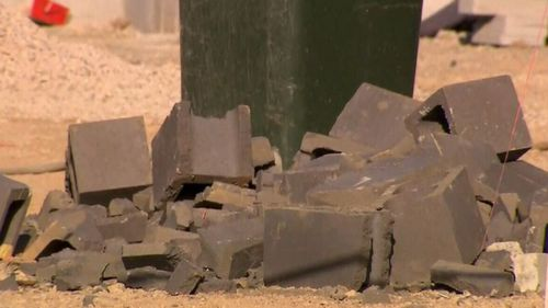 The workers was building a wall with concrete blocks when they collapsed and crushed him.