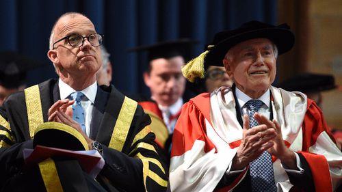 Former Australian Prime Minister John Howard seated beside Vice Chancellor Michael Spence. (AAP)