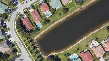 This Google Earth image showed a submerged car in a Florida retention pond.