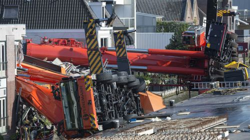 The two cranes lay on their sides after the accident in Alphen aan den Rijn. (AAP)