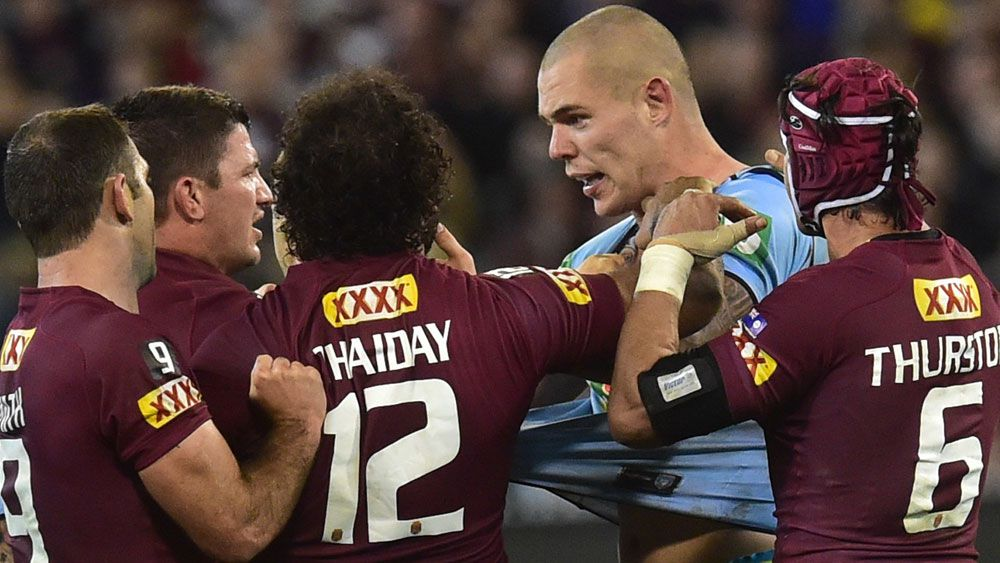David Klemmer gets in a tangle with Queensland players during the 2015 Origin series. (AAP)