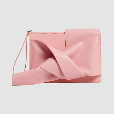 "<a href=""https://www.thedailyedited.com/peony-pink-knot-clutch"" target=""_blank"" draggable=""false"">The Daily Edit Peony Pink Knot Clutch, $179.95</a>"