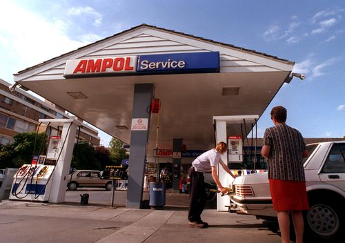 A man fills up his car in 1998 at the Ampol petrol station in Toorak, Melbourne.