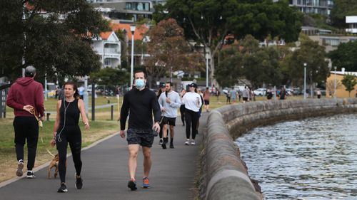People exercising in the early morning at Rushcutters Bay  in Sydney.