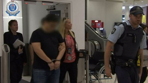 The man detained by police after arriving at Sydney Airport from China.