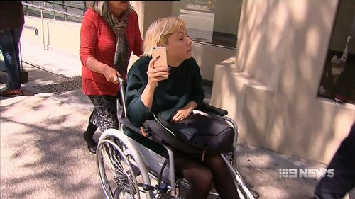 Today, Ms Gray turned up to court shaking, in a wheelchair. Mr Fry says she was perfectly fine dropping off her kid yesterday.