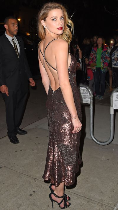 <p>In a backless Temperley London dress.</p>