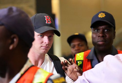 Steve Smith looked close to tears as he walked through the airport to leave South Africa. (AAP)