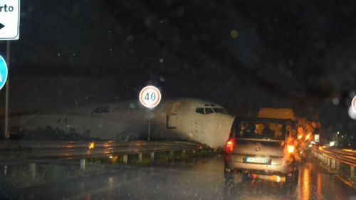 Plane overshoots runway and crashes on to Italian road