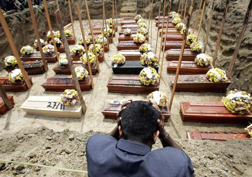 An Indonesian man looks over the mass grave site for unidentified victims of a Mandala Airlines flight A330 crash on September 2005 in Medan, Indonesia. Thirty-four of the nearly 150 people who were killed in the crash were buried in a mass grave near a cemetery used to bury victims of previous air crashes in the region.