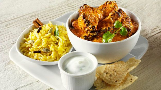 Lamb curry with spiced rice and yoghurt sauce