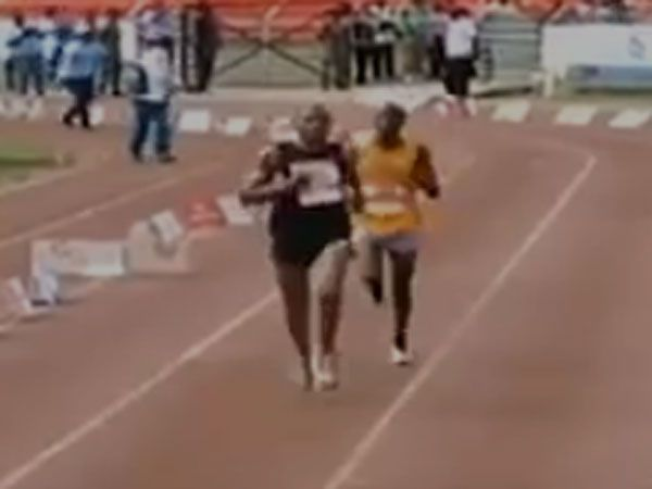 Julius Njogu surges past a rival to finish second in the Nairobi International Marathon. (Supplied)