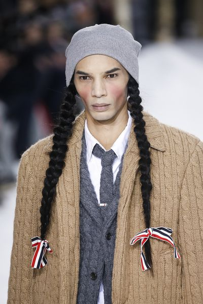 The master of tailoring sent male models down the Paris Runway with plaited pigtails and enough makeup to make Marie Antoinette cough into her cake