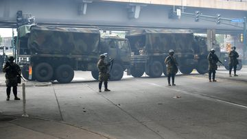 Minnesota National Guard deploy around the area of daily protests and looting as fires continue to burn following protests over the death of George Floyd