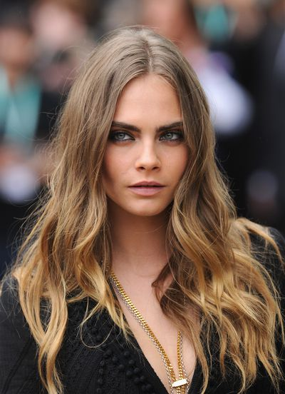 <p>Cara Delevinge has switched it up again and has stepped out as a brunette.</p> <p>The model, actress and author appeared at a launch for her newly-released novel Mirror Mirror with her hair shaped into a sweet pixie cut and dyed a rich hue of chocolate.</p> <p>Cara is something of a hair chameleon having worn her hair in dozens of different shades, styles and cuts in recent years. She's been fairy floss pink, metallic silver and shorn to the scalp.</p> <p>She's even hit the red carpet sporting hand-painted temporary tattoos across her skull, but this is the first time we've seen her rocking a lush brown - at least for nigh on a decade - and we have to say it suits her.</p> <p>The colour makes her tawny, hazel eyes look even more beautiful and it lifts her complexion too. All in all - we approve. Click through to see exactly what we mean and also, revisit some of Cara's more famed hair looks. </p>