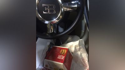 """This photo shows that he doesn't just collect Rolls Royce vehicles but is also open to driving other brands with this """"Bugatti Big Mac Edition"""" as proof. <br><br>His garage is filled with $19 million worth of cars."""