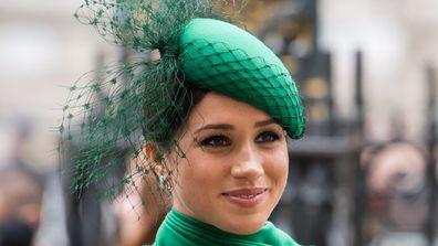 Meghan Markle smiling dressing in green