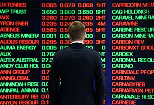 Man standing in front of ASX boards (AAP)