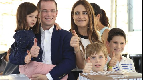 Presidential candidate Ricardo Anaya, of the PAN party, poses for photos with his family at a polling station during general elections in Queretaro, Mexico