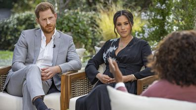 This image provided by Harpo Productions shows Prince Harry, from left, and Meghan, The Duchess of Sussex, in conversation with Oprah Winfrey. (Joe Pugliese/Harpo Productions via AP)