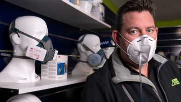 Director of On Site Safety Australia, Chris Bellamy demonstrating testing of a faulty face mask. Australia has been flooded with counterfeit mask since the coronavirus pandemic.