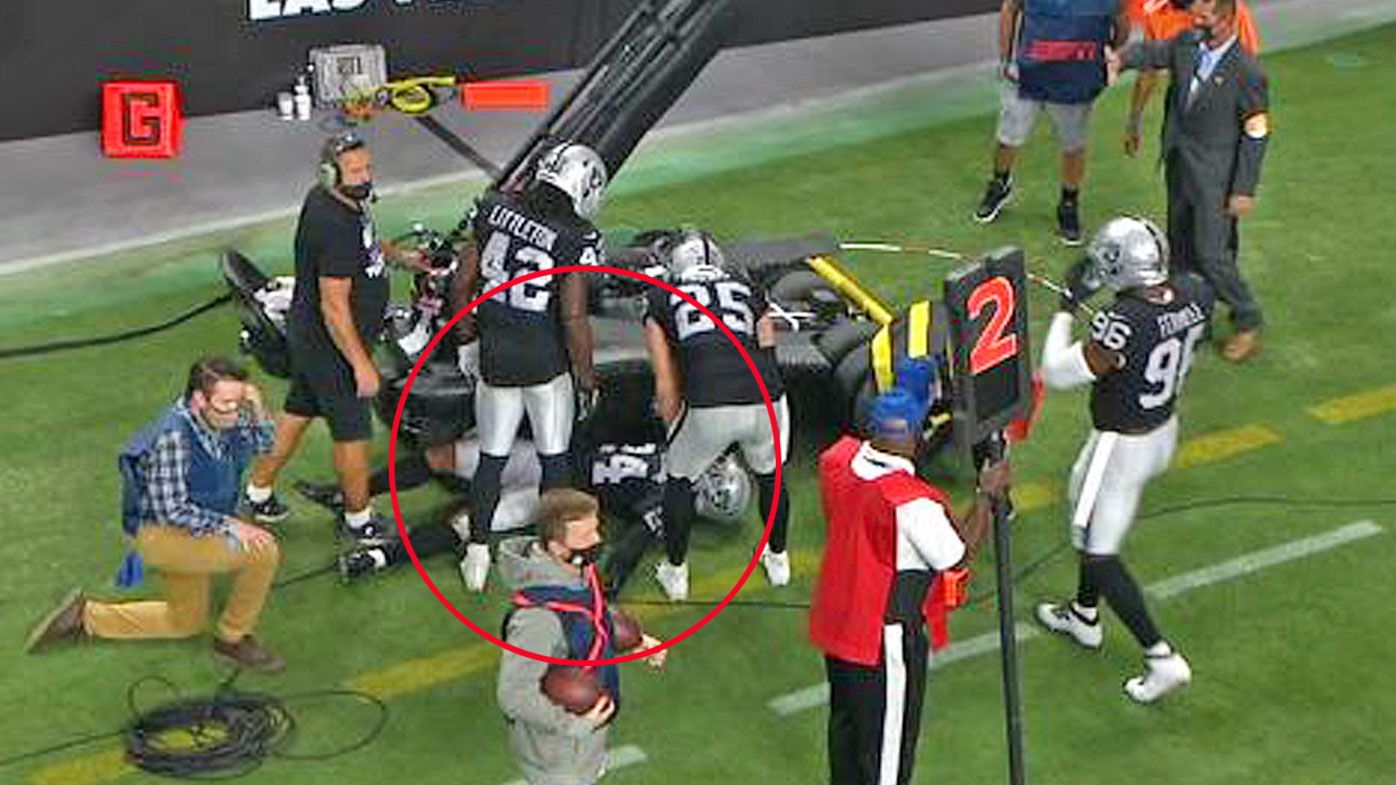 Raiders safety Abram collides with TV equipment on the sideline