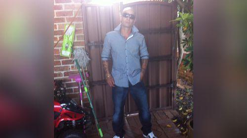 Police look into bikie links after Sydney man found on road dies