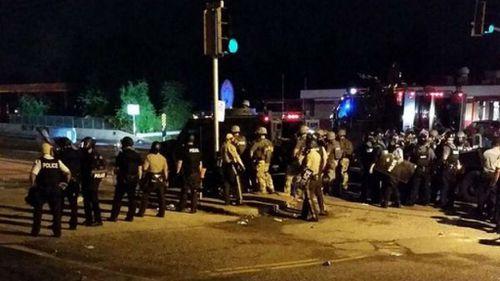 Riot police establish a line across a street in Ferguson. (Source: Twitter, @thetechCEO)