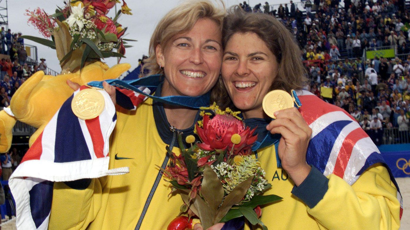 25 Sep 2000: Kerri Pottharst and Natalie Cook of Australia celebrate after their win over Brazil to win the Gold medal, in the final of the Women's Beach Volleyball at the Sydney 2000 Olympic Games, held at the Beach Volleyball Centre in Bondi, Sydney,Australia. DIGITAL IMAGE Mandatory Credit: Hamish Blair/ALLSPORT