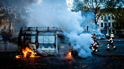 Protesters danced on the top of overturned cars and threw paving stones and fireworks during the protest, which opposes economic reforms announced by Prime Minister Charles Michel's centre-right coalition. (AAP)