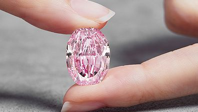 An 'ultra-rare' purple-pink diamond sells for a record $36.7 million at auction in Geneva
