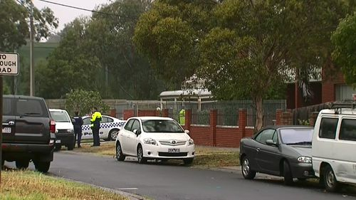 Man arrested after woman's body found in Melbourne unit