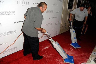 """Cleaners vacuum up the aftermath.<br/><br/><a href=""""http://news.ninemsn.com.au/entertainment/8440268/kardashian-flour-bombed-in-la"""">Read more at ninemsn NEWS: Kim Kardashian flour-bombed in LA</a>"""