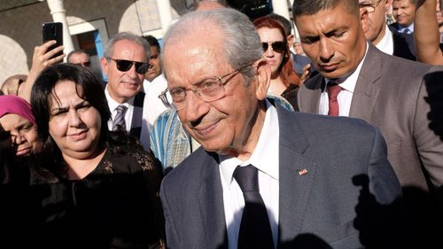 Tunisian Parliament Speaker Mohamed Ennaceur leaves parliament after being sworn in as Interim president in Tunis.