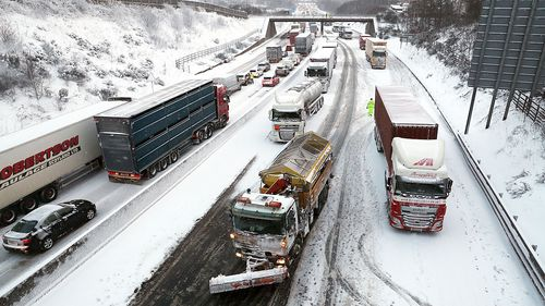 The scene on the M80 Haggs in Glasgow, as the highest level of weather warning has been issued for Scotland and Ireland. (AAP)