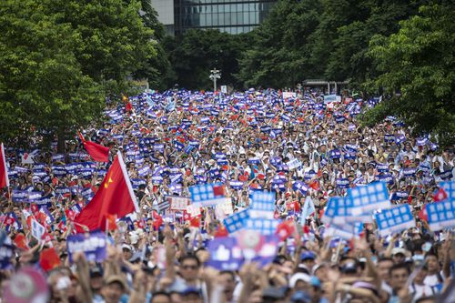 Tens of thousands of demonstrators gather outside of the Hong Kong government headquarters complex to show their support to the police as they fought largely against young demonstrators opposed to a now postponed plan to allow extraditions to mainland China.