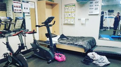 With the air-con blasting, this on-call firefighter was very happy with her bed on the floor of the gym. (Photo: Instagram, Missaimed)