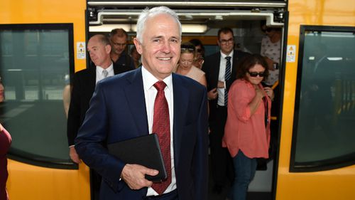 The Prime Minister will announce the revised funding plan for trains, roads and infrastructure today. (AAP)