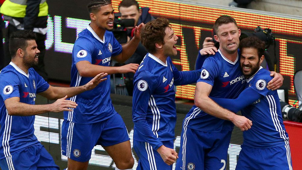 Chelsea's Gary Cahill is swamped by team-mates after scoring the winner. (AAP)