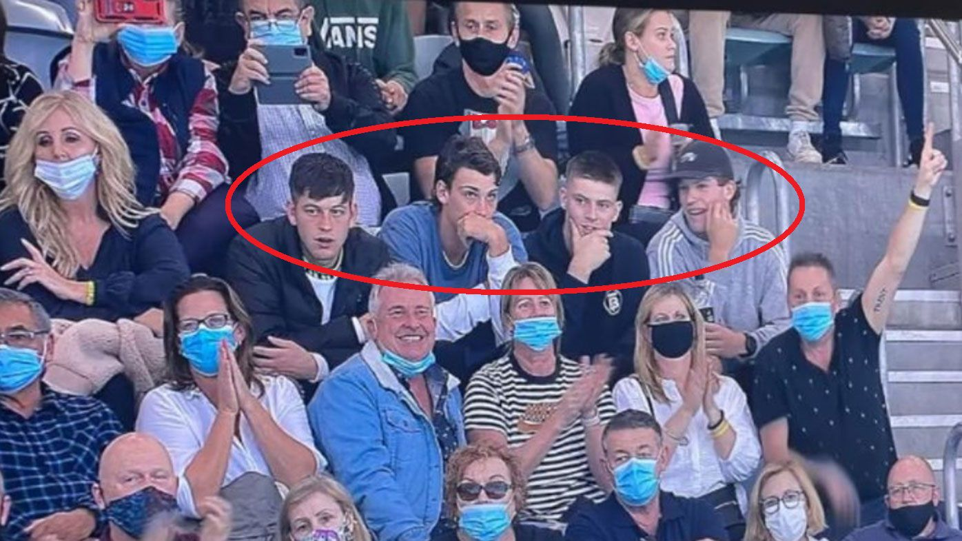 Four Port Adelaide players are in hot water after being seen without masks at the Olympic swimming trials.
