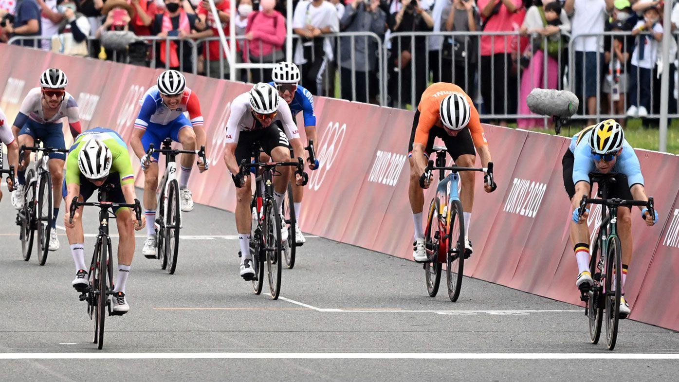 Wout van Aert (r) from Belgium finishes ahead of Tadej Pogacar (l) from Slovenia.