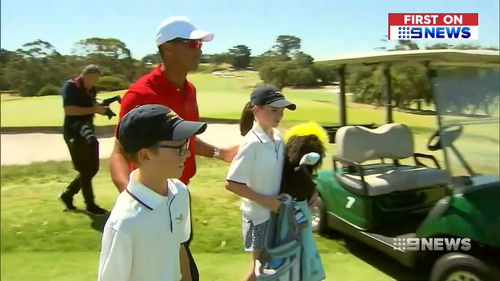 The champion golfer surprised young Melburnians, Hugo and Jemima.