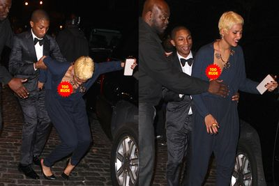 Even good looks can't save you when a wardrobe malfunction strikes. At least Helen Lasichanh had fiancé Pharrell Williams and his security on hand to pick her up after a nasty tumble left one of her breasts exposed.